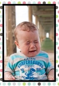 Sad baby under a jetty